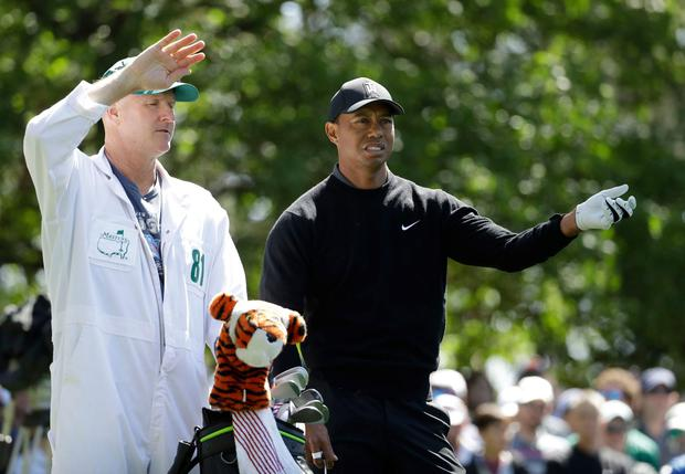 Tiger Woods and his caddie Joe LaCava consider the 14-time Major champion's options on the par-three fourth hole during yesterday's opening round at the US Masters. Photo: Matt Slocum/AP