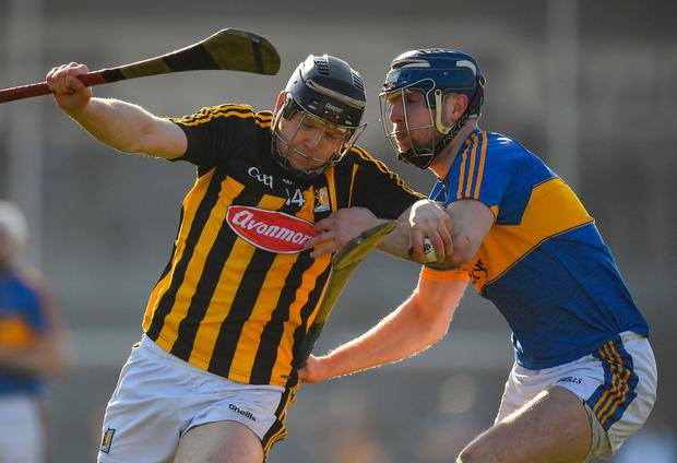 Walter Walsh of Kilkenny tries to force his way past Tipperary's Tomás Hamill during the teams' league clash in February – there will be no quarter asked or given again on Sunday. Photo: Brendan Moran/Sportsfile