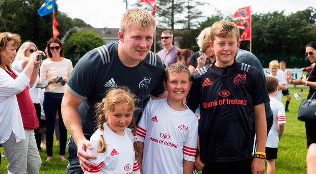 Munster rugby star John Ryan with children at a summer camp last year