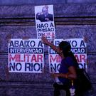 A supporter of former Brazil president Luiz Inacio Lula da Silva displays cardboards that read