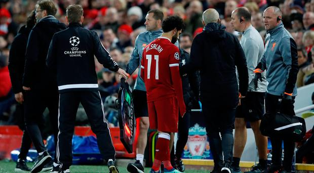 Liverpool's Mohamed Salah leaves the pitch as he is substituted after sustaining an injury