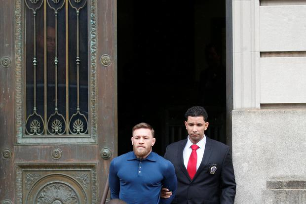 Conor McGregor is escorted by New York City Police (NYPD) detectives from the 78th police precinct after charges were laid against him in the Brooklyn borough of New York City, U.S., April 6, 2018. REUTERS/Brendan McDermid