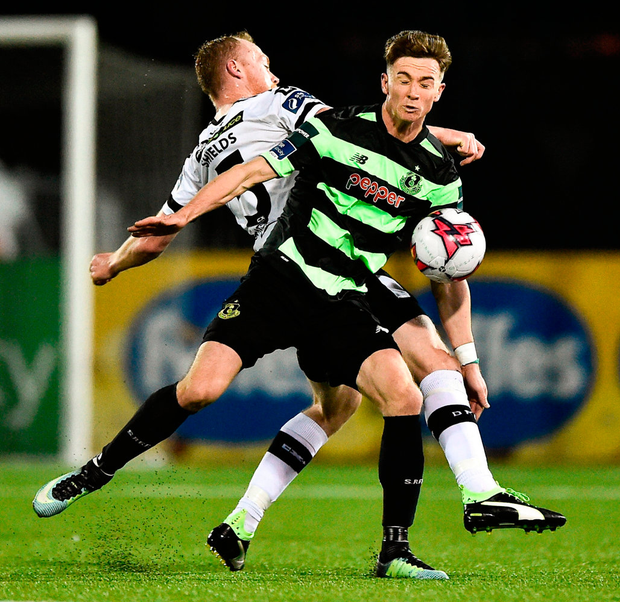 Ronan Finn of Shamrock Rovers battles against Dundalk's Chris Shields. Photo: Seb Daly/Sportsfile
