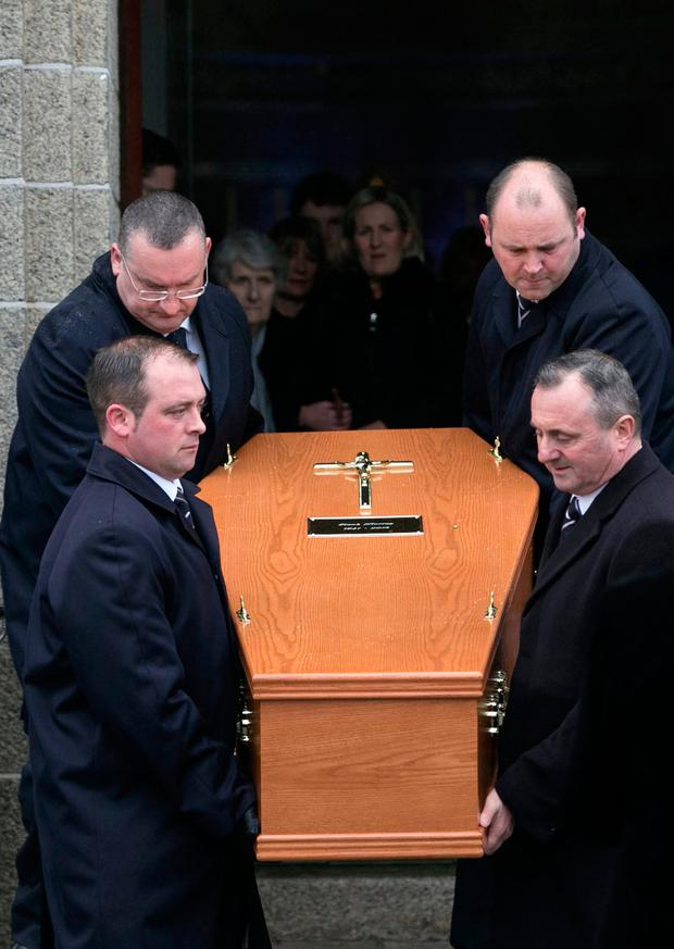 The coffin of Frank Murray is carried from the Church of Our Lady of Perpetual Succour in Foxrock, Dublin