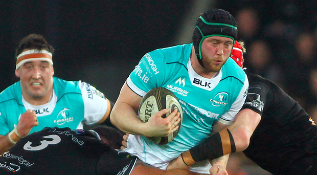 Connacht's Eoin McKeon is tackled by Ospreys' Ma'afu Fia (left) and Sam Cross. Photo: Sportsfile