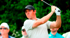 Rory McIlroy watches his drive on the 14th tee at Augusta National. Photo: Jamie Squire/Getty Images