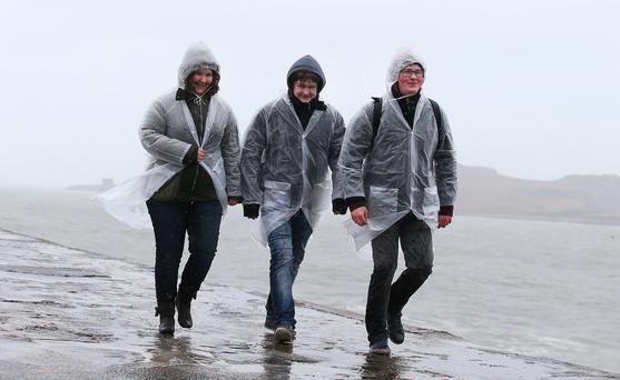 Anja, Jan and Andreas Lindemau, from Cologne, Germany, brave the wet weather during a trip to Howth, Co Dublin. Photo: Damien Eagers