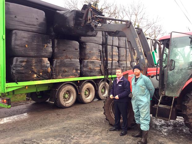 Martin Sexton (left), from Lakeland Agri, with farmer Gerard Reilly as fodder was delivered to his farm in Virginia, Co Cavan