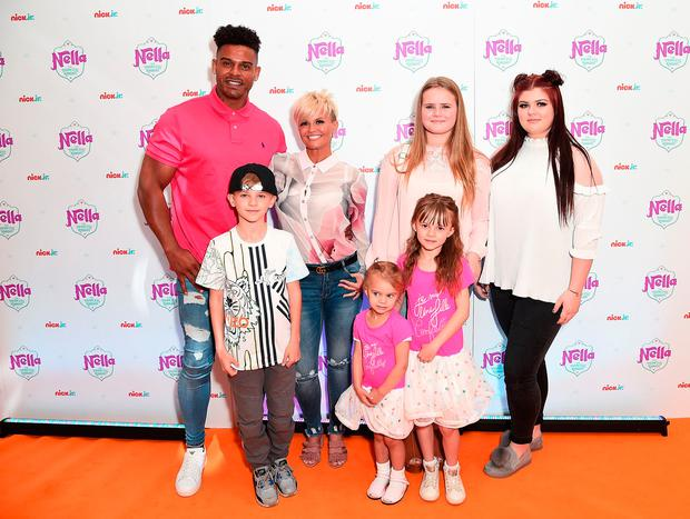 George Kay, Maxwell Mark Croft, Kerry Katona, Lilly-Sue McFadden, Molly McFadden and Heidi Croft attend the UK premiere for the brand new Nick Jr. show 'Nella the Princess Knight' at 11 Cavendish Square on May 14, 2017