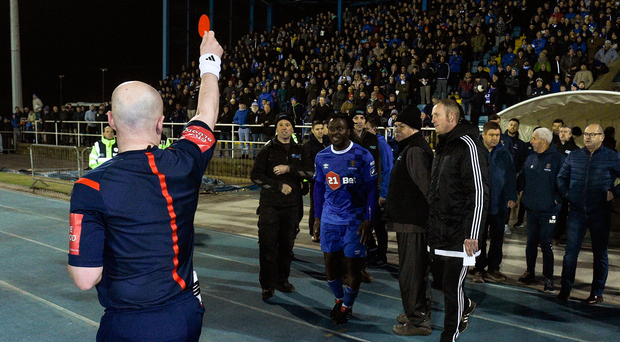 6 April 2018; Stanley Aborah of Waterford FC is shown a red card by referee Robert Rogers during the SSE Airtricity League Premier Division match between Waterford FC and Cork City at the RSC in Waterford. Photo by Matt Browne/Sportsfile