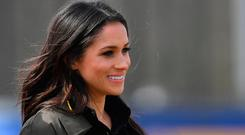 US actress Meghan Markle arrives to meet participants at the UK team trials for the Invictus Games Sydney 2018 at the University of Bath Sports Training Village in Bath, southwest England on April 6, 2018 with her fiancee Britain's Prince Harry