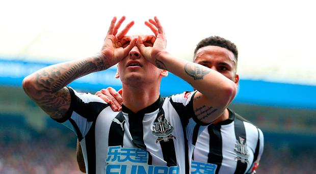 Newcastle United's Jonjo Shelvey (left) celebrates scoring his side's first goal of the game during the Premier League match at the King Power Stadium, Leicester. Steven Paston/PA Wire.
