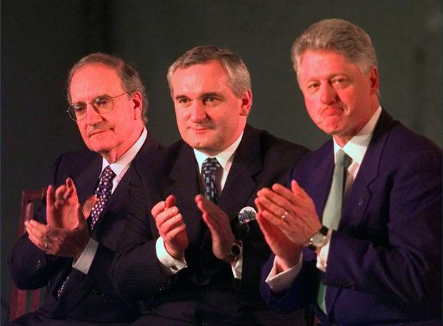 George Mitchell, Bertie Ahern and Bill Clinton back in the 1990s. They will all meet again this Tuesday to mark 20 years since the Good Friday Agreement. Photo: AP
