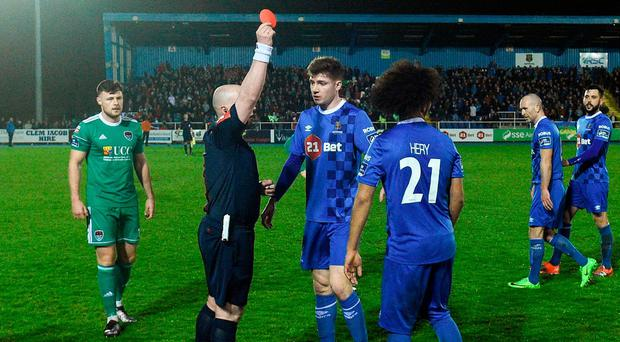 Waterford FC's Bastien Hery is shown a red card by referee Robert Rogers. Photo: Matt Browne/Sportsfile
