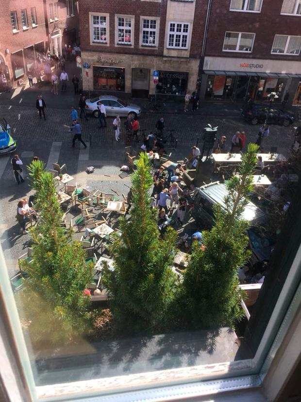 Chaos: The scene at the Kiepenkerl pub in Muenster, where a car ploughed into the crowd, killing three people