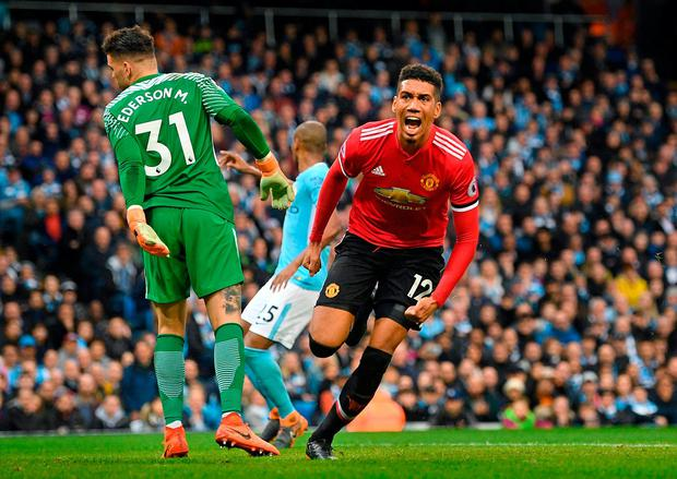 Chris Smalling celebrates after scoring Manchester United's winning goal in the Manchester derby at the Etihad Stadium yesterday. Photo: Michael Regan/Getty Images