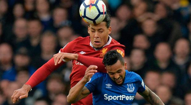 Everton's Theo Walcott in action with Liverpool's Virgil van Dijk. Photo: Peter Powell/Reuters