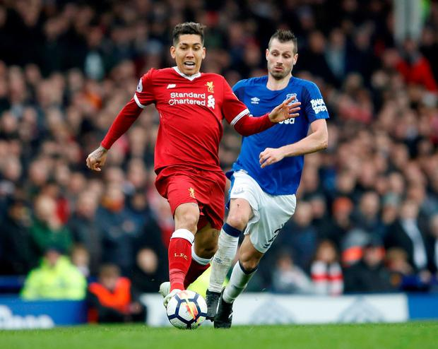 Liverpool's Roberto Firmino in action with Everton's Morgan Schneiderlin. Photo: Carl Recine/Action Images via Reuters
