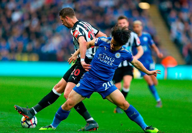 Newcastle United's Florian Lejeune (left) and Leicester City's Shinji Okazaki battle for the ball. Photo: Steven Paston/PA Wire