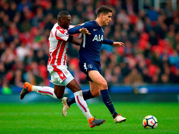 Stoke City's Bruno Martins Indi (left) and Tottenham Hotspur's Erik Lamela battle for the ball. Photo: Nigel French/PA Wire
