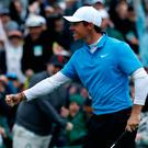 Rory McIlroy of Northern Ireland celebrates his birdie on the 18th hole during third round play of the 2018 Masters golf tournament at the Augusta National Golf Club in Augusta, Georgia, U.S. April 7, 2018. REUTERS/Jonathan Ernst