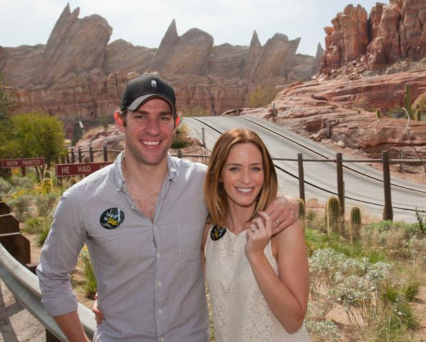 John Krasinski and Emily Blunt pose at the Cars Land attraction at Disney's California Adventure on July 27, 2012 in Anaheim, California. (Photo by Paul Hiffmeyer/Disney Parks via Getty Images)
