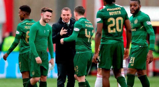 Celtic manager Brendan Rodgers celebrates with his players at the end of the game