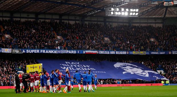 Chelsea fans hold up a banner in memory of Ray Wilkins before the match REUTERS/Eddie Keogh