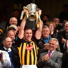 Kilkenny captain Cillian Buckley lifts the cup following the Allianz Hurling League Division 1 Final match between Kilkenny and Tipperary at Nowlan Park in Kilkenny