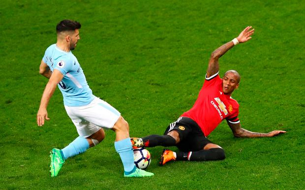 Ashley Young challenges Sergio Aguero in an incident which wasn't deemed to be a foul by referee Martin Atkinson.