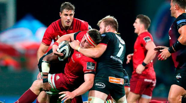 Munster's CJ Stander is tackled by Tienie Burger of the Southern Kings. Photo: Luke Walker/Sportsfile