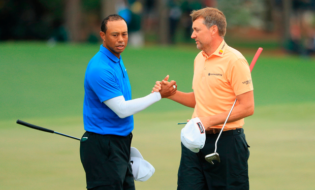 Tiger Woods of the United States and Ian Poulter of England. Photo: Getty Images