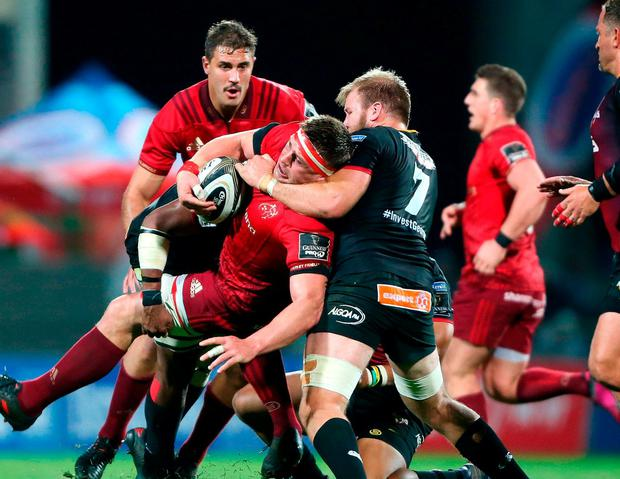 Munster's CJ Stander is tackled by Southern Kings' Tienie Burger. Photo: Luke Walker/Sportsfile