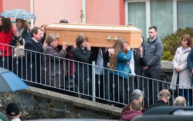 Mourners at the funeral of Darragh Killeen at Inch Church, Co Clare, on Saturday. The 19-year-old and his cousin Oisín Cahill (18) died following a crash in the early hours of Easter Sunday