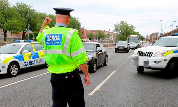 A member of the Garda Traffic Corps during a checkpoint. Photo: Frank McGrath