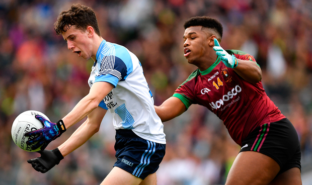 Michael Brady of Rice College in action against Leo Monteiro of St Ronan's College. Photo: Sportsfile