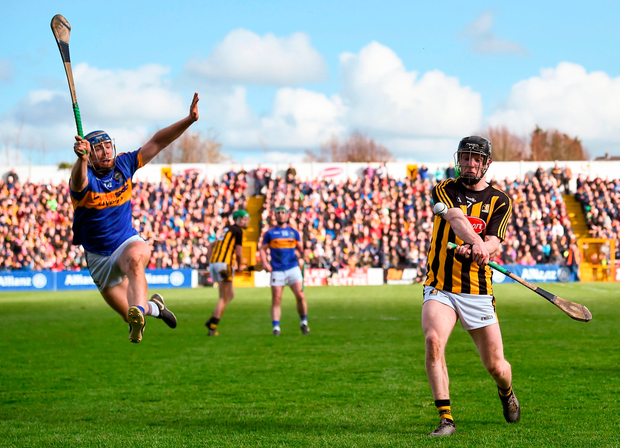 Kilkenny's Enda Morrissey gets his shot away despite the attempted block of Jason Forde of Tipperary during the Allianz NHL final. Photo: Sportsfile