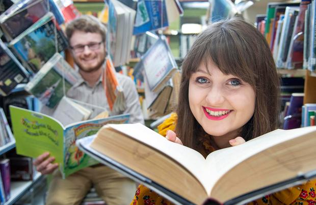 Johnathan Fehily from Cork City Library with festival volunteer Alison Driscoll, who is also a UCC student on the creative writing MA course. They are preparing for the Cork World Book Festival. Photo: Gerard McCarthy