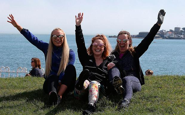 Claire Maher, Sabrina Brennan and Rosin Foley soak up the sun. Photo: Stephen Collins/Collins Photos