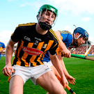 Kilkenny's Joey Holden is shouldered over the sideline by Tipperary's Jason Forde during the Allianz NFL Division 1 final. Photo: Sportsfile