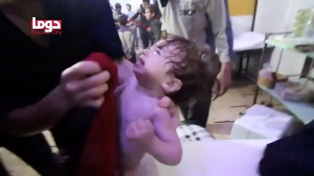 A child cries as they have their face wiped following alleged chemical weapons attack, in what is said to be Douma, Syria in this still image from video obtained by Reuters on April 8, 2018. White Helmets/Reuters TV via REUTERS THIS IMAGE HAS BEEN SUPPLIED BY A THIRD PARTY.
