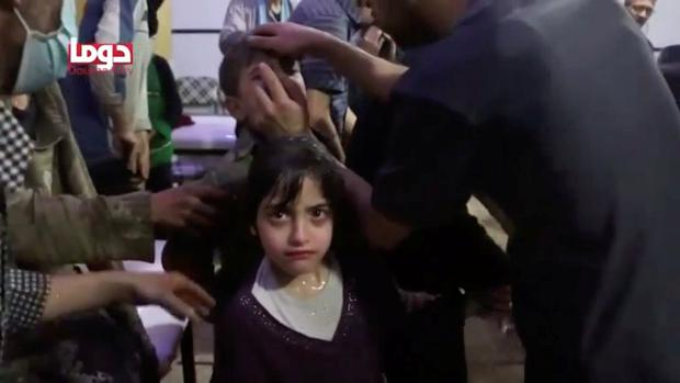 A girl looks on following alleged chemical weapons attack, in what is said to be Douma, Syria in this still image from video obtained by Reuters on April 8, 2018. White Helmets/Reuters