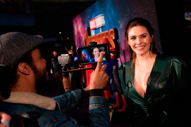 Elizabeth Olsen attends the UK Fan Event to celebrate the release of Marvel Studios' 'Avengers: Infinity War' at The London Television Centre on April 8, 2018 in London, England. (Photo by Gareth Cattermole/Gareth Cattermole/Getty Images for Disney)
