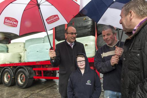 Farmer Dan Bourke and his son Brandon (9) from Kilcorney, Millstreet at the Dairygold Co-Op branch in Millstreet, Cork speaking with the Minister for Agriculture, Food and the Marine, Michael Creed (right) and Dairygold CEO Jim Woulfe as a delivery of imported fodder from the UK arrives to the Co-Op for distribution. Pic Michael Mac Sweeney/Provision