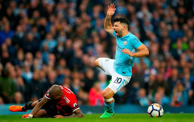 Manchester City's Sergio Aguero (right) and Manchester United's Ashley Young battle for the ball during the Premier League match at the Etihad Stadium