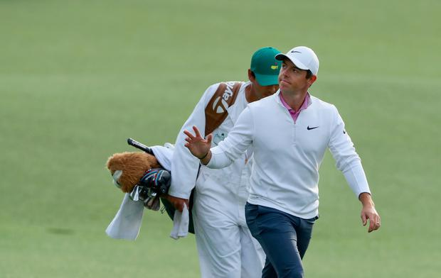 Rory McIlroy of Northern Ireland and caddie Harry Diamond walk up the 18th green during the final round of the 2018 Masters Tournament at Augusta