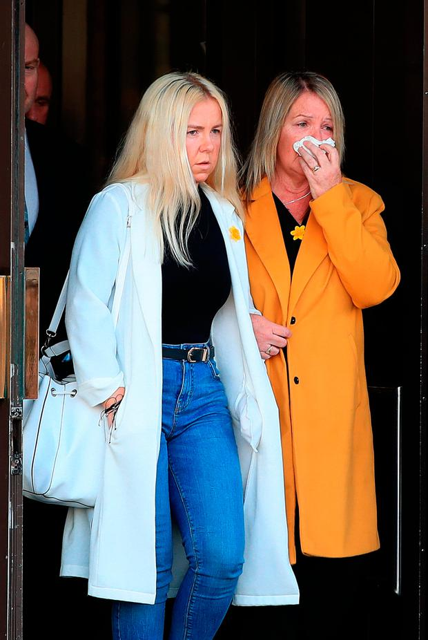 Tracy Hayes (right) the mother of murdered travel agent Cassie Hayes, leaves Liverpool Crown Court, with her other daughter Nadine , as Andrew Burke, 31, who murdered Ms Hayes at a Tui branch in Southport after she began a relationship with his ex-girlfriend, has been jailed for a minimum of 26 years at the court. Peter Byrne/PA Wire