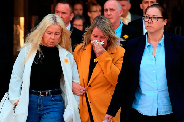 Tracy Hayes (right) the mother of murdered travel agent Cassie Hayes, leaves Liverpool Crown Court, with her other daughter Nadine, as Andrew Burke, 31, who murdered Ms Hayes at a Tui branch in Southport after she began a relationship with his ex-girlfriend, has been jailed for a minimum of 26 years at the court. Peter Byrne/PA Wire