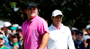 Patrick Reed of the U.S. (L) and Rory McIlroy of Northern Ireland. Photo: Reuters