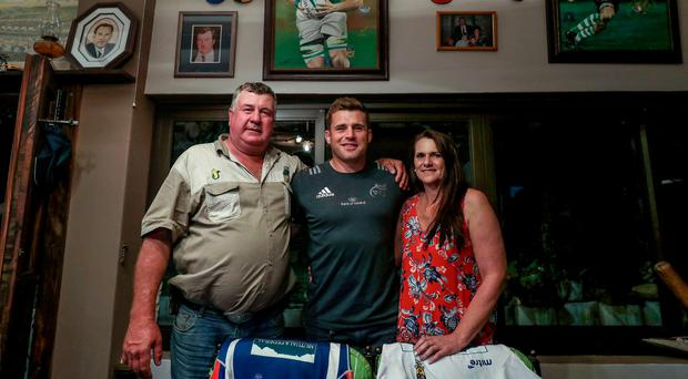 CJ Stander with his parents Jannie and Amanda in the family home, which is packed with memorabilia of his career to date Photo: INPHO/Dan Sheridan